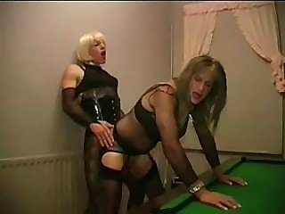 Two sexy crossdressers fun on a pool table