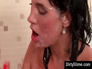Covered in fake cum from a fake white cock a young slutty brunette savors the...