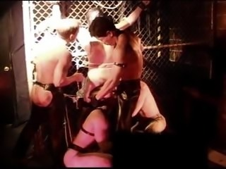 CBT BDSM orgy at San Francisco sex club with leather, muscles and big cocks.