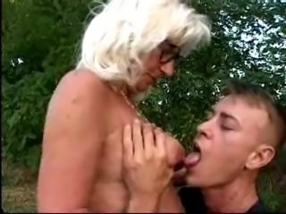 Mature gets fucked and facialized outside