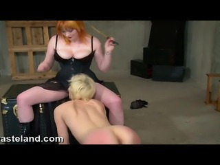 A copper haired FemDom plays with Her blonde lesbian slave.