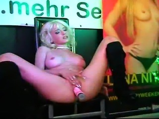 Mia Magma gives a hot Dildo Show during an erotic fair in front of audience...