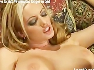 A gorgeous blonde with big tits fucks as