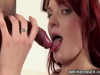 Young redhead dresses in a sexy bodystocking before giving the blowjob of her...