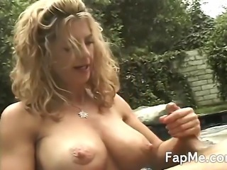 Big tit girl gives a nice handjob and takes a load of cum all over he boobs