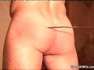 Totally nude guy has hands tied and ass spanked