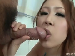 Japanese cutie Rika Aina kneels and plays with a dick