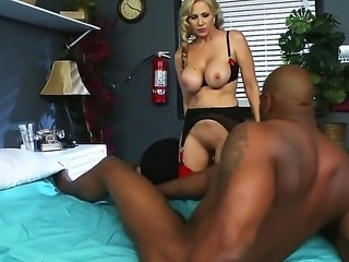 Mature blonde Julia Ann enjoys interracial hardcore fucking along Lucas Stone