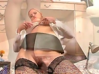The MILF pornstar Sandra de Marco demonstrates her hairy cunt in front of the...