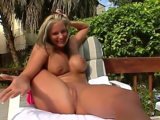 Wonderful girl with a nice tanned body Phoenix Marie gets naked on camera,...