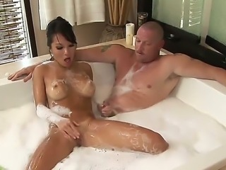 The fantastic Asian babe Asa Akira makes a handjob to her boyfriend in the...