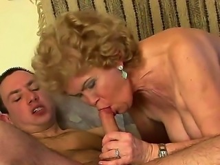 Bewitching granny Effie is getting her sexy feet licked and pussy devoured by...