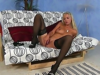 The naughty blonde whore Chikita in black stockings penetrates her peach with...