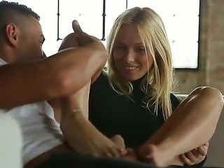 Foot fetish scene with a horny blonde babe whose name is Lina Napoli