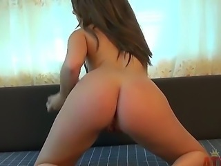 Turned on long haired brunette beauty Cali Hayes with natural boobs and sexy...
