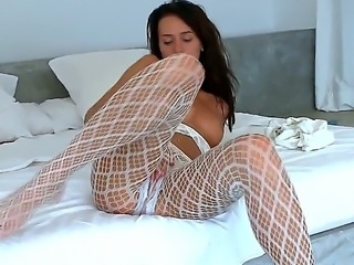 Bewitching babe Monica in super sexy pantyhose poses, strips and masturbates...