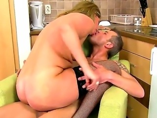 Horny mature blonde honey Laura Long enjoys in her passionate kitchen sex...