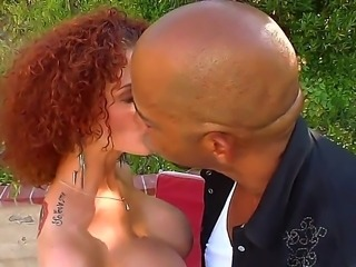 Curly haired redhead Joslyn James shows