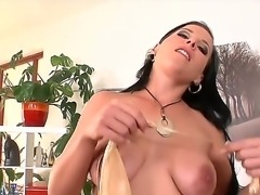 Fascinating brunette lady with sexy tits and delicious big nipples caresses...