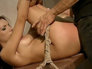 Hardcore BDSM action with a beautiful and sexy brunette named Vivien Bianchy