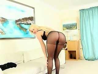Black sexy pantyhose in hotel apartment