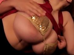 Big tits Hitomi Tanaka on the sofa wearing a golden bikini
