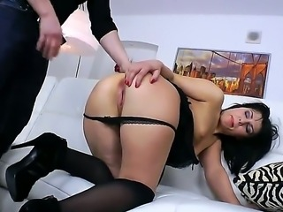 Raven haired beauty Bella Marchelli need some anal stretching before taking...