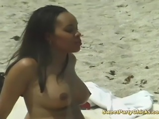 Big tits babe on the beach