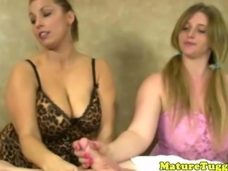 Mature handjob lovers jerking off a stud