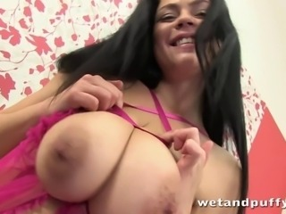 Shione teases with her big tits and shoves her whole fist up her tight pussy