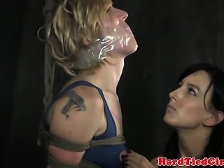 Restrained slut being flagellated