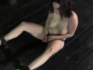 Mouth hooked skank being restrained on the dungeon