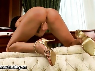 Blonde Sybilla groans as she fucks herself with fingers