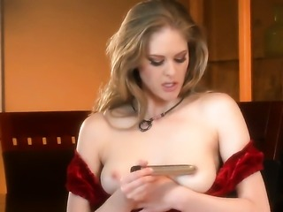 With smooth pussy is curious about playing with her honeypot on camera
