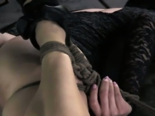 Restrained sub getting her pussy teased
