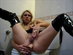 Pierced mature toying her ass