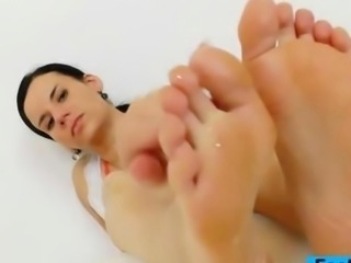 Dark fake penis gets a footjob