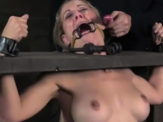 Restrained sub held in stocks and gagged