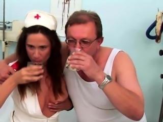 Brunette nurse got caught sucking old doctors cock