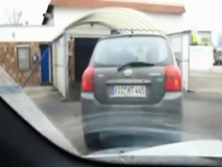 Dirty slut giving blowjob in car
