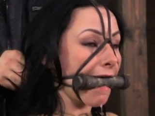 BDSM sub muzzled and restrained by dom