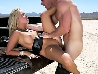 Beautiful blonde Alexis Monroe with sexy boobs spreads her legs wide open in...