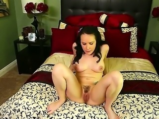Completely naked brunette Katie St. Ives with natural titties strokes her...