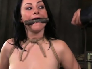 Sexy restrained sub wearing a bit gag