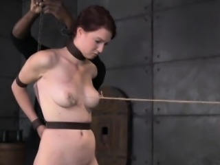 Restrained sub obeying her cruel master