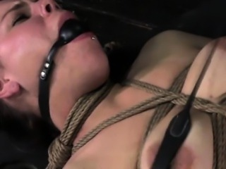 Box restrained bastinado brunette