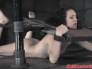 Restrained bdsm sub punished with bastinado by her master