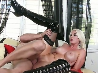 Blonde bitch with leather boots stars in australian porn. She is wearing...