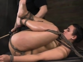 Restrained submissive being canned and fucked with dildo