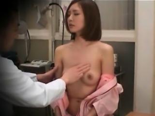 Sweet Japanese girl pissing for a pregnancy test